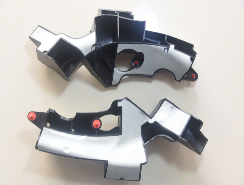 Overmolded plastic parts for Geely